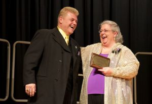 Harmony Heritage Director Bob'Oconnell and President Gayle Jordan accept the Betty Costellow Small Chorus Award