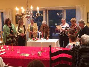 Mary Ann Archibald lights the candle of Membership
