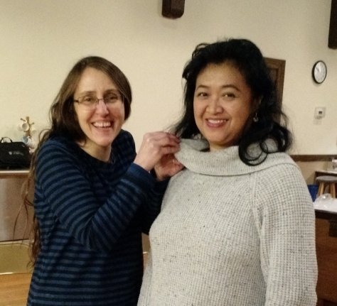 President Kim Thompson presents Sylvia Izzo with her official Harmony Inc. pin.